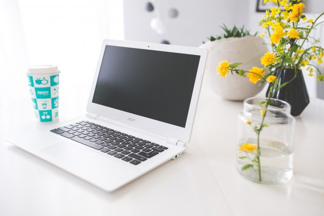 laptop in minimalistic office with flowers